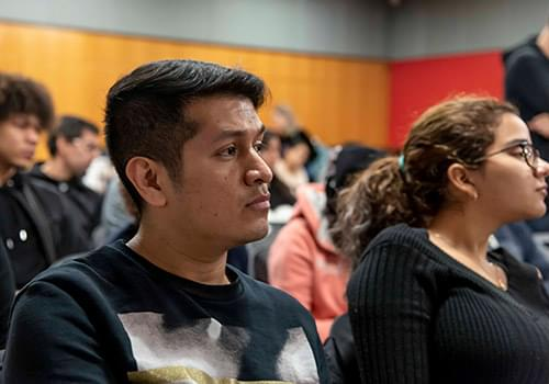 Students listening to a speech