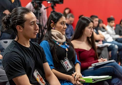 Students attending a conference on immigration