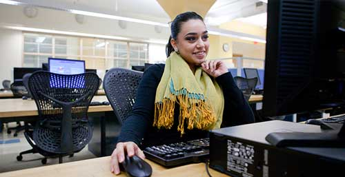 Student sitting in Front of a Computer in the Computer Lab