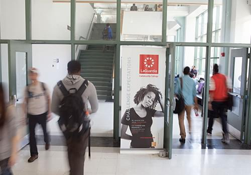 Students walking around the E-Building hallways