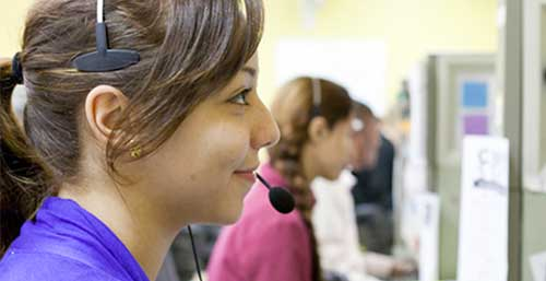 Staff Memeber Answering Phonce Calls while wearing a Headset