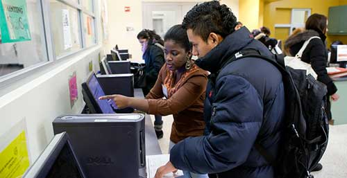 Student Being Helped in the Finanacial Aid Office in Room C-107