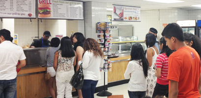 Students in line to get food at the cafeteria