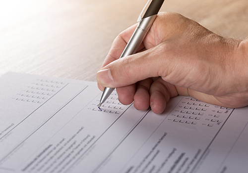 Person filling out a voting ballot